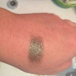 Urban-Decay-Moondust-Zodiac-swatch-artificial-light